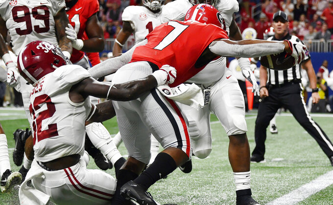 Georgia running back D'Andre Swift (7) runs into the end zone against Alabama linebacker Dylan Moses (32) during the first half of the Southeastern Conference championship NCAA college football game, Saturday, Dec. 1, 2018, in Atlanta. (AP Photo/John Amis)