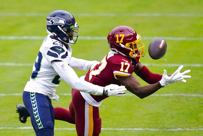Washington Football Team wide receiver Terry McLaurin (17) juggles with a ball and is unable to make the catch while being covered by Seattle Seahawks free safety D.J. Reed (29) during the first half of an NFL football game, Sunday, Dec. 20, 2020, in Landover, Md. (AP Photo/Susan Walsh)