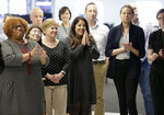 Associated Press staff applaud as the list of Pulitzer Prize winners are announced at AP headquarters in New York, Monday, April 15, 2019. A team of three Associated Press journalists won a Pulitzer Prize in international reporting Monday for their work documenting torture, graft and starvation in Yemen's brutal civil war. (AP Photo/Seth Wenig)