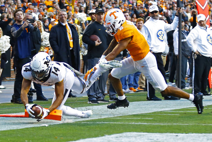 Missouri wide receiver Dominic Gicinto (14) dive into the end zone for a touchdown as he's defended by Tennessee defensive back Alontae Taylor (6) in the first half of an NCAA college football game Saturday, Nov. 17, 2018, in Knoxville, Tenn. (AP Photo/Wade Payne)