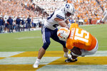 Tennessee wide receiver Jauan Jennings (15) catches a touchdown pass as he's defended by Brigham Young defensive back Sawyer Powell (28) in the first half of an NCAA college football game Saturday, Sept. 7, 2019, in Knoxville, Tenn. (AP Photo/Wade Payne)