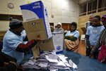An electoral worker empties a ballot box for counting in view of party agents after the close of polls at the Parkhurst Primary School in Johannesburg, South Africa Wednesday, May 8, 2019. South Africans are voting Wednesday in a national election that pits President Cyril Ramaphosa's ruling African National Congress against top opposition parties Democratic Alliance and Economic Freedom Fighters, 25 years after the end of apartheid. (AP Photo/Ben Curtis)