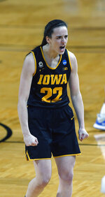 Iowa guard Caitlin Clark (22) react after hitting a three during the first half of a college basketball game in the second round of the women's NCAA tournament at the Greehey Arena in San Antonio, Tuesday, March 23, 2021. (AP Photo/Ronald Cortes)