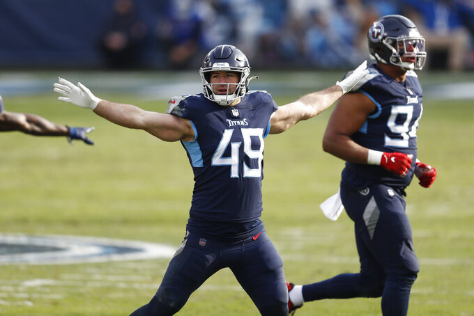 Tennessee Titans linebacker Nick Dzubnar (49) signals that a field goal attempt by the Baltimore Ravens is not good in the second half of an NFL wild-card playoff football game Sunday, Jan. 10, 2021, in Nashville, Tenn. (AP Photo/Wade Payne)