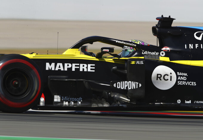 Renault driver Daniel Ricciardo of Australia steers his car during a practice session prior to the Formula One Grand Prix at the Barcelona Catalunya racetrack in Montmelo, Spain, Friday, Aug. 14, 2020. (Bryn Lennon, Pool via AP)