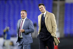 New England Patriots quarterback Tom Brady, right, walks with offensive coordinator Josh McDanields walk on the field at M&T Bank Stadium prior to an NFL football game against the Baltimore Ravens, Sunday, Nov. 3, 2019, in Baltimore. (AP Photo/Julio Cortez)
