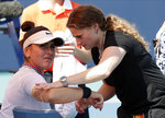 Bianca Andreescu, left, of Canada, receives medical treatment from Lisa Pataky, of the WTA, during her match against Anett Kontaveit, of Estonia, during the Miami Open tennis tournament, Monday, March 25, 2019, in Miami Gardens, Fla. Andreescu retired from the match. (AP Photo/Lynne Sladky)