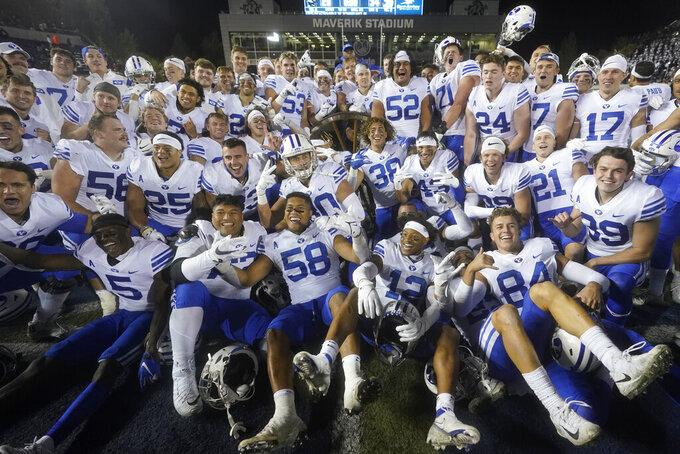 BYU players pose following their NCAA college football game against Utah State Friday, Oct. 1, 2021, in Logan, Utah. (AP Photo/Rick Bowmer)