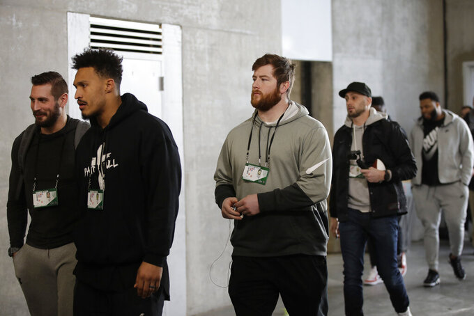 New England Patriots' Joe Thuney, center, and other players arrive for a NFL football walkthrough, Saturday, Feb. 2, 2019, in Atlanta, ahead of Super Bowl 53 against the Los Angeles Rams. (AP Photo/Matt Rourke)