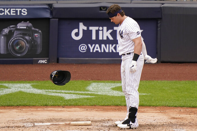New York Yankees Luke Voit (59) tosses his helmet after striking out in the fifth inning of a baseball gam against the Baltimore Orioles, Sunday, Sept. 13, 2020, at Yankee Stadium in New York. (AP Photo/Kathy Willens)