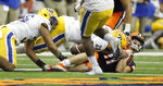 Syracuse's Clayton Welsh, right, is tackled by Pittsburgh's Kylan Johnson, left, during the fourth quarter of an NCAA college football game in Syracuse, N.Y., Friday, Oct. 18, 2019. Pittsburgh won 27-20. (AP Photo/Nick Lisi)