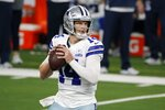 Dallas Cowboys quarterback Andy Dalton (14) drops back to pass in the second half of an NFL football game against the New York Giants in Arlington, Texas, Sunday, Oct. 11, 2020. (AP Photo/Michael Ainsworth)