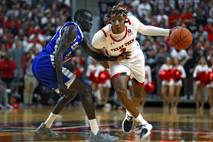 Texas Tech's Jahmi'us Ramsey (3) drives the ball around Eastern Illinois' Deang Deang (25) during the second half of an NCAA college basketball game Tuesday, Nov. 5, 2019, in Lubbock, Texas. (AP Photo/Brad Tollefson)