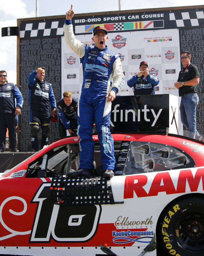 A.J. Allmendinger celebrates in Victory Lane after winning the B&L Transport 170 NASCAR Xfinity Series auto race at Mid-Ohio Sports Car Course on Saturday, June 5, 2021, in Lexington, Ohio. (AP Photo/Tom E. Puskar)