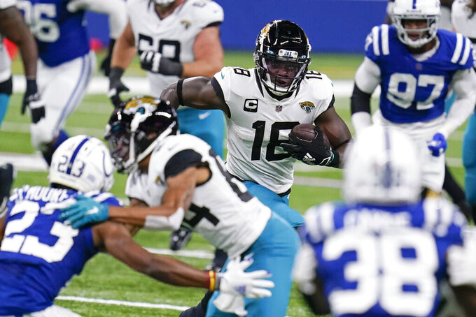 Jacksonville Jaguars wide receiver Chris Conley (18) runs during the second half of an NFL football game against the Indianapolis Colts, Sunday, Jan. 3, 2021, in Indianapolis. (AP Photo/Michael Conroy)
