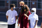 Prince Harry and Meghan, the Duke and Duchess of Sussex walk with students during their visit to P.S. 123, the Mahalia Jackson School, in New York's Harlem neighborhood, Friday, Sept. 24, 2021. (AP Photo/Richard Drew)