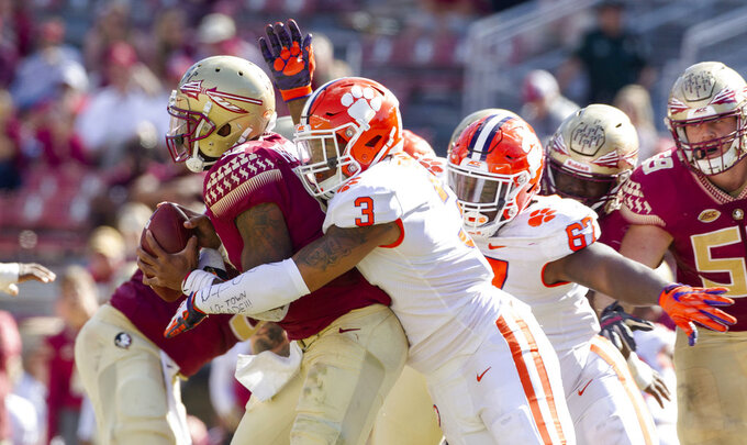 Clemson defensive end Xavier Thomas (3) and Albert Huggins sack Florida State quarterback Deondre Francois in the second half of an NCAA college football game in Tallahassee, Fla., Saturday, Oct. 27, 2018. Clemson defeated Florida State 59-10. (AP Photo/Mark Wallheiser)