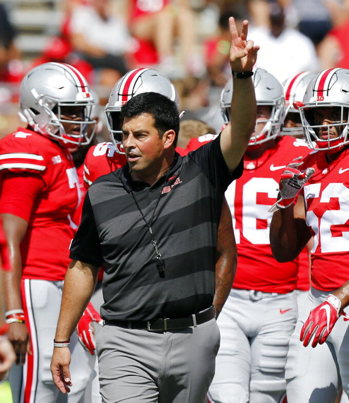 FILE - In this Saturday, Sept. 1, 2018, file photo, Ohio State's acting head coach Ryan Day directs warm-ups before an NCAA college football game against Oregon State in Columbus, Ohio. No. 15 TCU gets another chance for the Big 12 against No. 4 Ohio State. The Horned Frogs and Buckeyes will play Saturday night at the home stadium of the NFL's Dallas Cowboys. (AP Photo/Jay LaPrete, File)