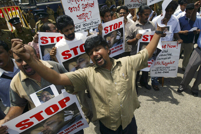 FILE- In this May 23, 2008 file photo, Sri Lankan journalists shout slogans during a protest demanding the government investigate into abduction and assault of fellow journalist Keith Noyahr in Colombo, Sri Lanka. Forced to flee their country a decade ago to escape allegedly state-sponsored killer squads, Sri Lankan journalists living in exile doubt they'll be able to return home soon or see justice served to their tormentors _ whose alleged ringleader could come to power in this weekend's presidential election. Exiled journalists and media rights groups are expressing disappointment over the current government's failure in punishing the culprits responsible for crimes committed against media members. (AP Photo/Eranga Jayawardena, File)