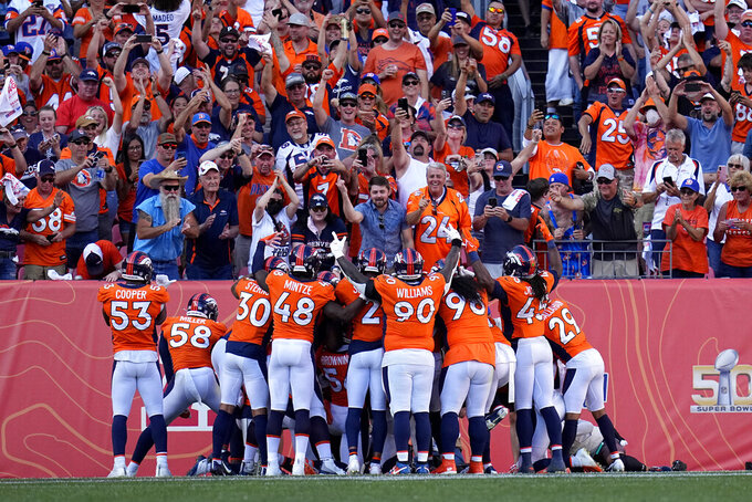 Denver Broncos defensive players celebrate an interception against the New York Jets during the second half of an NFL football game, Sunday, Sept. 26, 2021, in Denver. (AP Photo/Jack Dempsey)