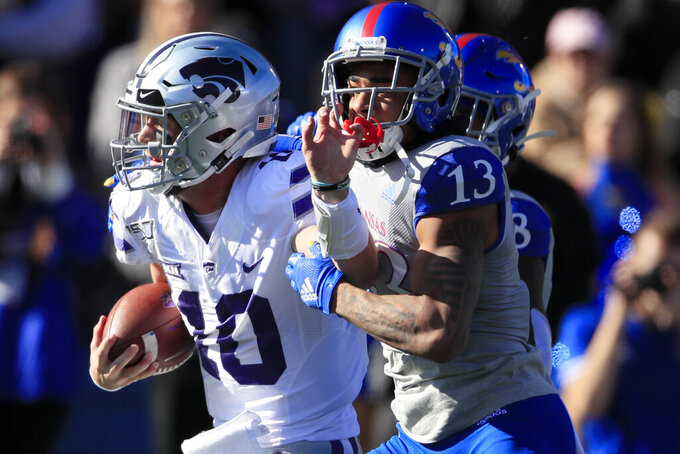 Kansas State quarterback Skylar Thompson (10) is tackled just short of the goal line by Kansas cornerback Hasan Defense (13) during the first half of an NCAA college football game in Lawrence, Kan., Saturday, Nov. 2, 2019. (AP Photo/Orlin Wagner)