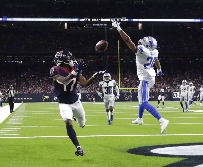 Houston Texans wide receiver Vyncint Smith (17) catches a pass for a touchdown as Detroit Lions defensive back Andrew Adams (24) defends during the first half of an NFL preseason football game Saturday, Aug. 17, 2019, in Houston. (AP Photo/Michael Wyke)