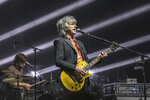 """This photo provided by Crowded House shows Neil Finn of the band Crowded House performing at a concert in Auckland, New Zealand, Saturday, April 24, 2021. Touring as a member of Fleetwood Mac in 2018-19 made Neil Finn appreciate the memorable band in his own history. Two years later, Finn has brought that group, Crowded House, back to life with his sons Liam and Elroy, producer Mitchell Froom and original bass player Nick Seymour. A new album, """"Dreamers Are Waiting,"""" arrives Friday. (Crowded House/Steve Dykes via AP)"""