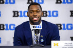 Michigan running back Hassan Haskins talks with reporters during an NCAA college football news conference at the Big Ten Conference media days, Thursday, July 22, 2021, at Lucas Oil Stadium in Indianapolis. (AP Photo/Doug McSchooler)
