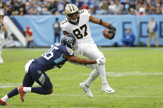 New Orleans Saints tight end Jared Cook (87) breaks a tackle by Tennessee Titans cornerback LeShaun Sims (36) as Cook scores a touchdown against the New Orleans Saints in the first half of an NFL football game Sunday, Dec. 22, 2019, in Nashville, Tenn. (AP Photo/James Kenney)