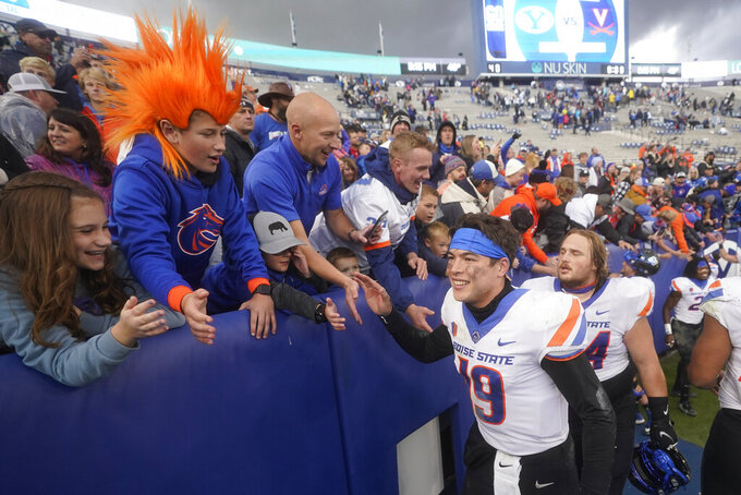 Boise State quarterback Hank Bachmeier (19) celebrates with fans following an NCAA college football game against BYU, Saturday, Oct. 9, 2021, in Provo, Utah. (AP Photo/Rick Bowmer)
