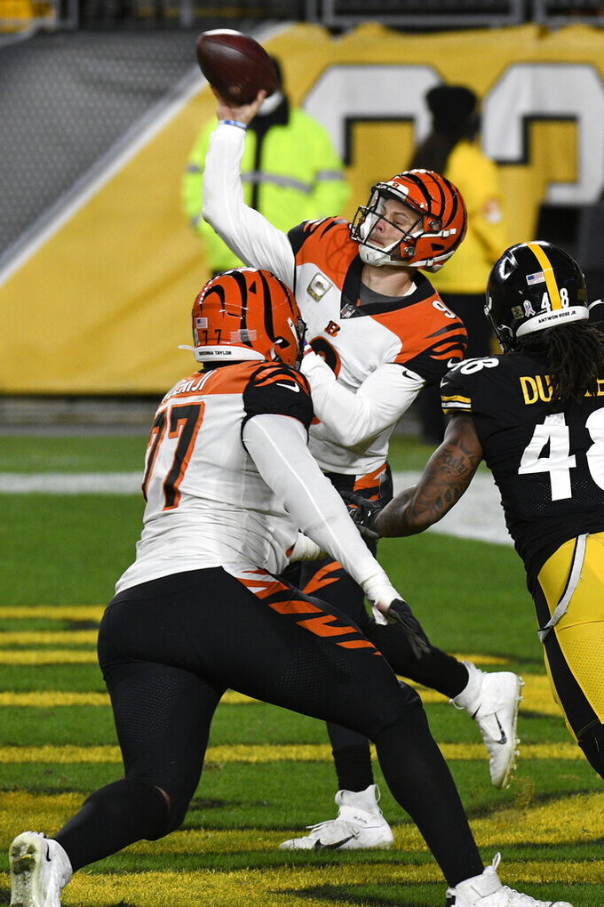 Cincinnati Bengals quarterback Joe Burrow (9) throws a pass during the second half of an NFL football game against the Pittsburgh Steelers in Pittsburgh, Sunday, Nov. 15, 2020. (AP Photo/Don Wright)