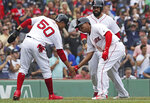 Boston Red Sox's Rafael Devers, right, is congratulated by Mookie Betts after hitting a three-run home run during the fifth inning of a baseball game against the Toronto Blue Jays at Fenway Park in Boston, Thursday, July 18, 2019. (AP Photo/Charles Krupa)