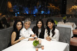 From left, members of the An family, Elizabeth, her mother Helene, daughter Basilika and sister Catherine pose for a photo at the family's restaurant Crustacean Beverly Hills Monday, May 13, 2019, in Beverly Hills, Calif. On May 18, the Smithsonian Asian Pacific American Center launches a $25 million fundraising drive for permanent gallery space on the National Mall in Washington, D.C. with a glitzy party in Los Angeles full of celebrities and politicians. (AP Photo/Marcio Jose Sanchez)