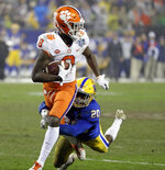Clemson's Justyn Ross (8) is tackled buy Pittsburgh's Dennis Briggs (20) after a catch in the second half of the Atlantic Coast Conference championship NCAA college football game in Charlotte, N.C., Saturday, Dec. 1, 2018. (AP Photo/Chuck Burton)