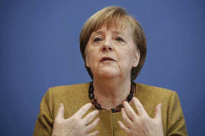 German Chancellor Angela Merkel talks to the media during a press conference on the current situation in Berlin, Germany, Thursday, Jan. 21, 2021. Topics include the decisions taken by the federal and state governments to combat the Corona pandemic, the Chancellor's upcoming virtual consultations with the heads of state and government of the European Union (EU), and relations with the United States following the inauguration of the new president. (Michael Kappeler/Pool via AP)