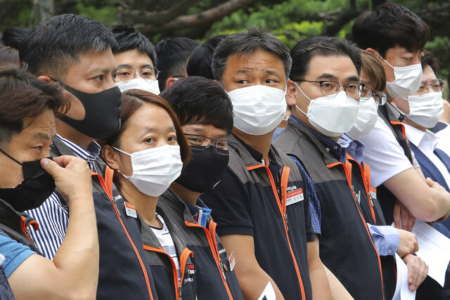 Financial union members wearing face masks to help protect against the spread of the new coronavirus attend a rally against government's financial policy in front of the Financial Supervisory Service in Seoul, Monday, June 29, 2020. (AP Photo/Ahn Young-joon)