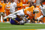 Tennessee quarterback Hendon Hooker (5) dives for the goal line as he's tackled by Tennessee Tech defensive back Jalon Baker (4) during the first half of an NCAA college football game Saturday, Sept. 18, 2021, in Knoxville, Tenn. (AP Photo/Wade Payne)