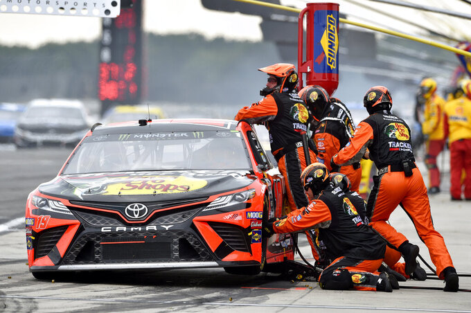 Martin Truex Jr. makes a pit stop during a NASCAR Cup Series auto race, Sunday, July 28, 2019, in Long Pond, Pa. (AP Photo/Derik Hamilton)