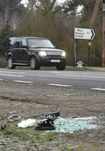 Broken glass and car parts on the road side near to the Sandringham Estate, England, where Prince Philip was involved in a road accident Thursday while he was driving, Friday Jan. 18, 2019. Witnesses say Queen Elizabeth II's 97-year old husband Prince Philip was helped out of his car after it rolled over in the accident on the busy road. (John Stillwell/PA via AP)