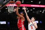Wisconsin forward Aleem Ford (2) shoots for two points with Richmond forward Tyler Burton (3) defending during the first half of an NCAA college basketball game in the Legends Classic, Monday, Nov. 25, 2019, in New York. (AP Photo/Kathy Willens)