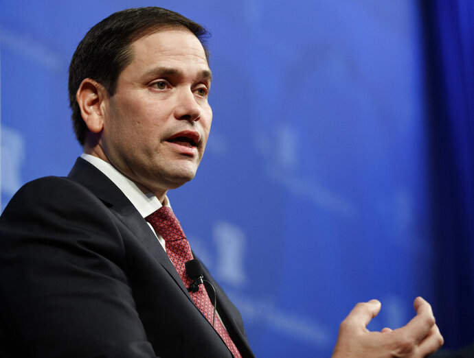 """FILE - In this Monday, Feb. 11, 2019, file photo, U.S. Sen. Marco Rubio, R-Fla., speaks at the Heritage Foundation in Washington, about the crisis in Venezuela. Rubio is warning Venezuela's President Nicolas Maduro that tyrants often think they are """"invulnerable"""" before their regimes topple. (AP Photo/Carolyn Kaster, File)"""