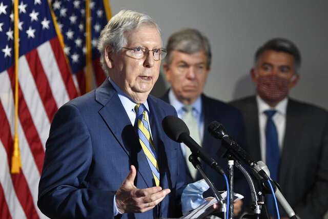 FILE - In this June 9, 2020, file photo Senate Majority Leader Mitch McConnell of Ky., left, speaks to reporters following the weekly Republican policy luncheon on Capitol Hill in Washington. Sen. Roy Blunt, R-Mo., center, and Sen. Cory Gardner, R-Colo., right, listen. Republican senators are fighting to save their majority against an onslaught of challengers in states once off limits to Democrats that are now hotbeds of the backlash to President Donald Trump and his allies on Capitol Hill. (AP Photo/Susan Walsh, File)