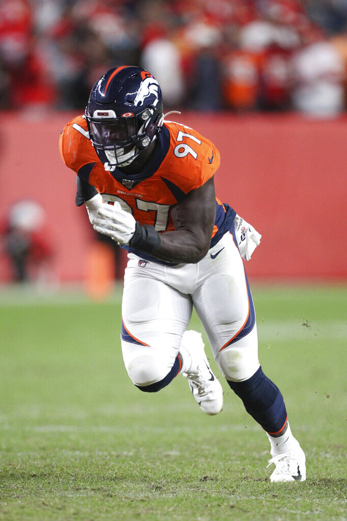 Denver Broncos linebacker Jeremiah Attaochu (97) takes a defensive position during an NFL game against the Kansas City Chiefs, Thursday, Oct. 17, 2019, in Denver. The Chiefs defeated the Broncos 30-6. (Margaret Bowles via AP)