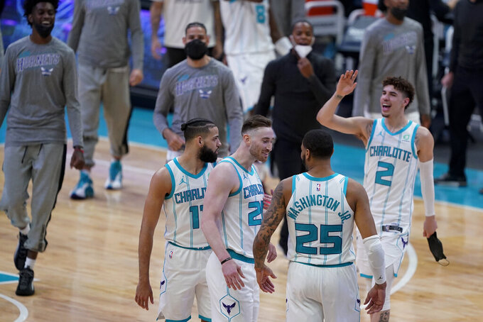Members of the Charlotte Hornets celebrate after their win against the Sacramento Kings during the second half of an NBA basketball game on Monday, March 15, 2021, in Charlotte, N.C. (AP Photo/Chris Carlson)