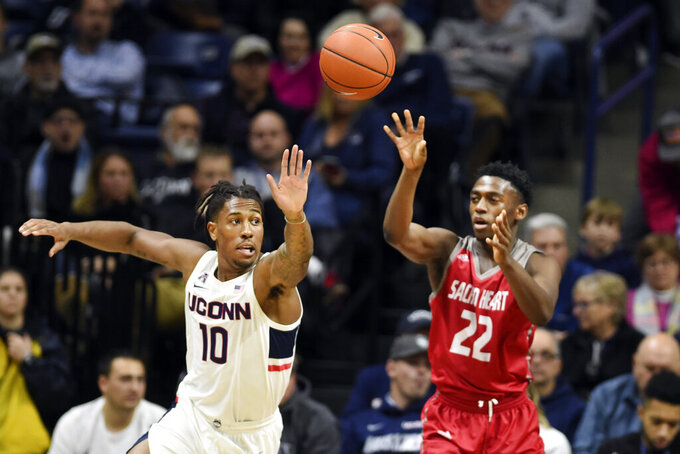 Connecticut's Brendan Adams (10) chases down the ball against Sacred Heart's Tyler Thomas (22) in the first half of an NCAA college basketball game, Friday, Nov. 8, 2019, in Storrs, Conn. (AP Photo/Stephen Dunn)
