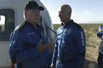 """In this image provided by Blue Origin, William Shatner talks with Jeff Bezos about his experience after exiting the Blue Origin capsule near Van Horn, Texas, Wednesday, Oct. 13, 2021.  The """"Star Trek"""" actor and three fellow passengers hurtled to an altitude of 66.5 miles (107 kilometers) over the West Texas desert in the fully automated capsule, then safely parachuted back to Earth in a flight that lasted just over 10 minutes.  (Blue Origin via AP)"""