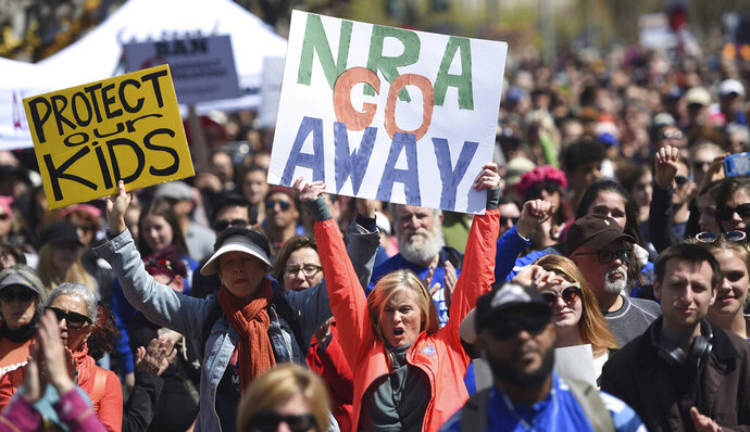 FILE - In this March 24, 2018, file photo, crowds of people participate in the March for Our Lives rally in support of gun control in San Francisco. The National Rifle Association of America dropped on Thursday, Nov. 7, 2019, its lawsuit against the city of San Francisco over a resolution passed by the Board of Supervisors labeling the gun lobby a terrorist organization. (AP Photo/Josh Edelson, File)