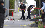 Chicago police investigate the scene of a shooing Tuesday, Aug. 4, 2020, on Oak Street in Chicago. The shooting left one person dead and two inured, authorities said. (Chris Sweda/Chicago Tribune via AP)