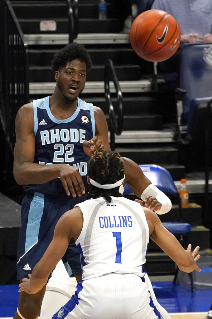 Rhode Island's Makhel Mitchell (22) passes over Saint Louis' Yuri Collins (1) during the first half of an NCAA college basketball game Wednesday, Feb. 10, 2021, in St. Louis. (AP Photo/Jeff Roberson)