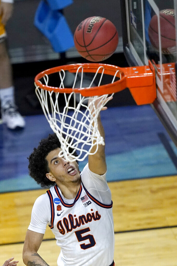 Illinois guard Andre Curbelo scores during the first half of a first round NCAA college basketball tournament game against Drexel Friday, March 19, 2021, at the Indiana Farmers Coliseum in Indianapolis .(AP Photo/Charles Rex Arbogast)